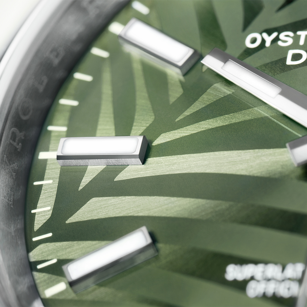 Closeup image of rolex datejust with green dial