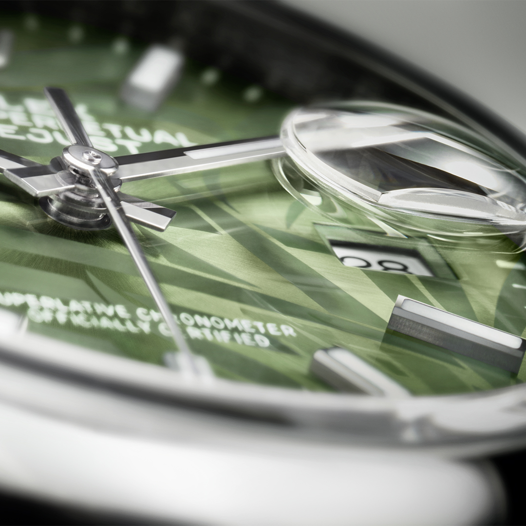 Closeup image of Rolex Datejust with green dial from angle