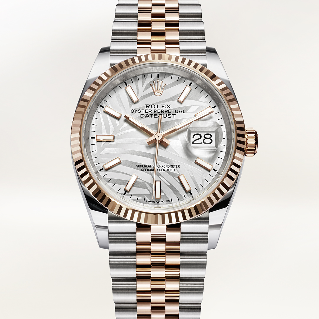 Rolex Datejust in rose gold and stainless steel with palm motifs dial