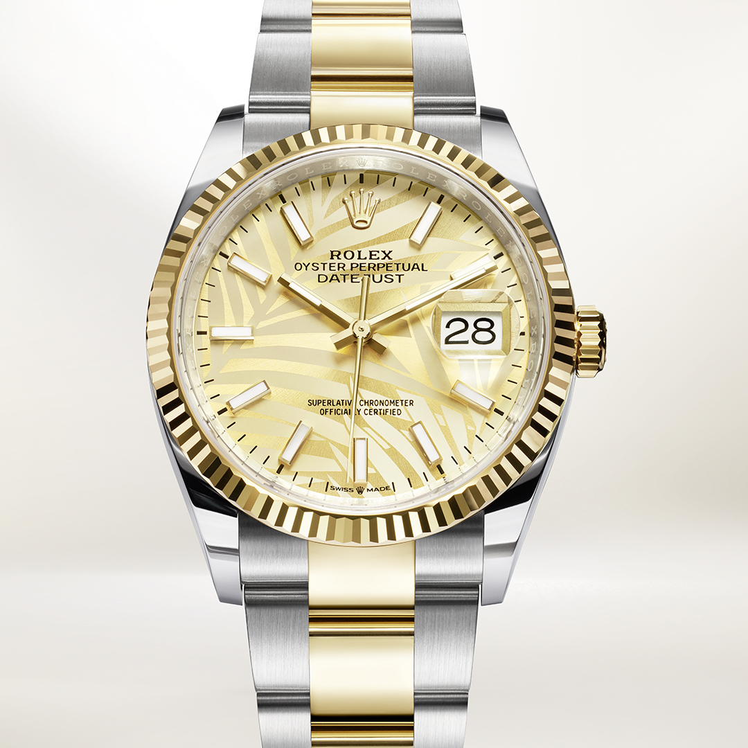 Rolex Datejust in yellow gold and stainless steel with palm motifs dial